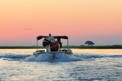 A CNP boat on its way back home at sunset on the Chobe River.