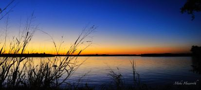 Half an hour after the sun had set the colours in the evening sky become beautifully saturated over the Chobe River.