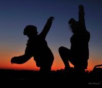 Sammy and Lauren fooling around at sunset in Mashatu