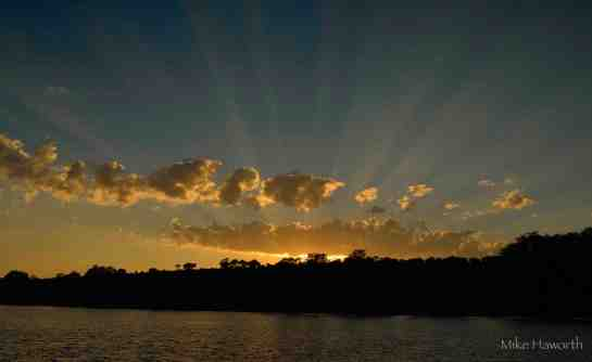 Breath -taking shafts of morning light beaming through the clouds at around 6h15 on the Chobe river in April